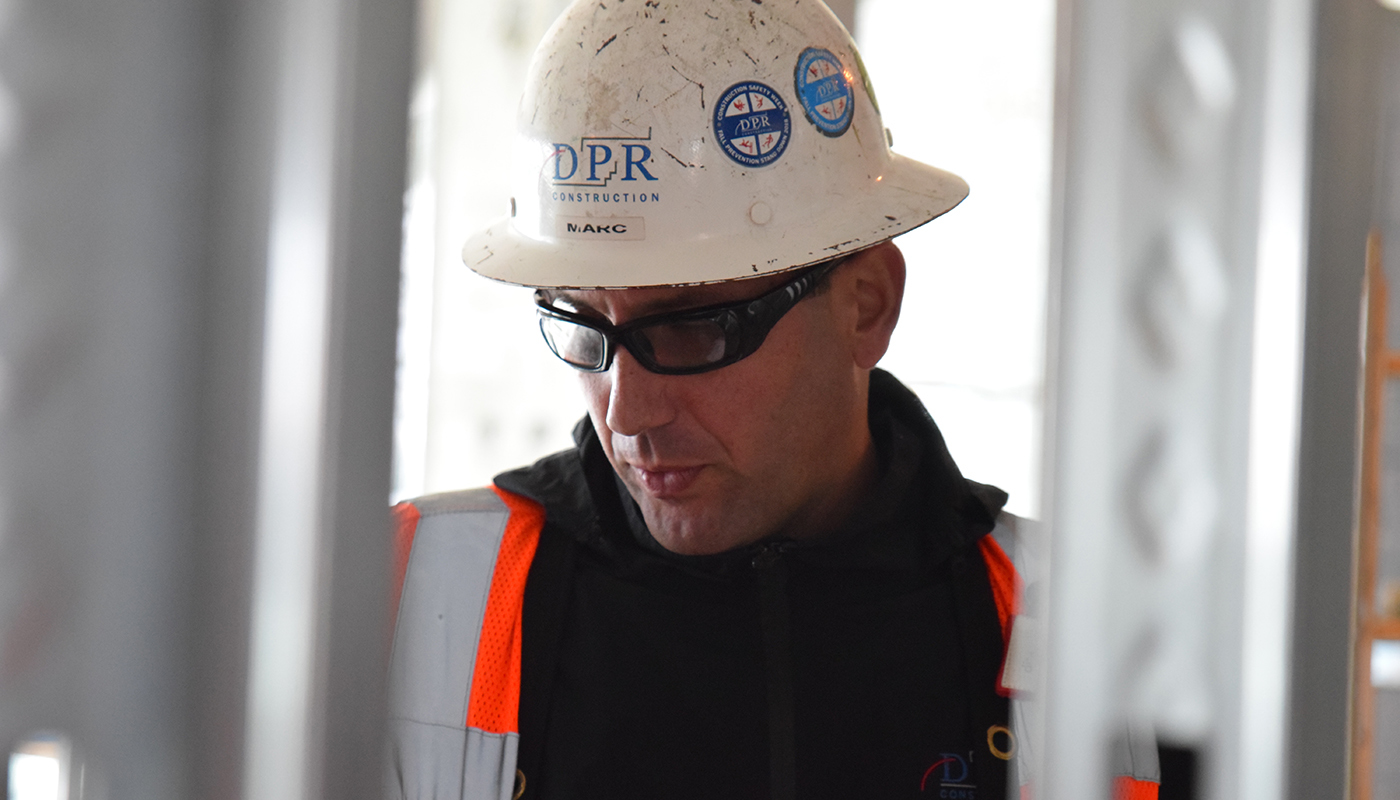 DPR's Marc Agulla examines his work area.