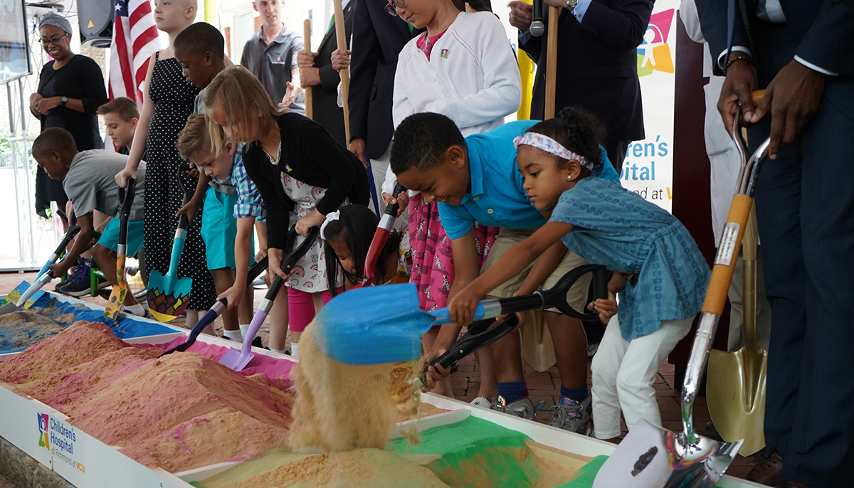Children participate in the groundbreaking of the new VCU children's hospital.
